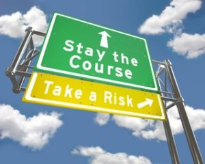 The good news is you don't have to choose, you can take the risk and keep the day job