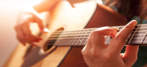 Take the guitar start with one song at a time rather than being the next rockstar